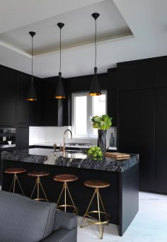 Black style kitchen design next to living room