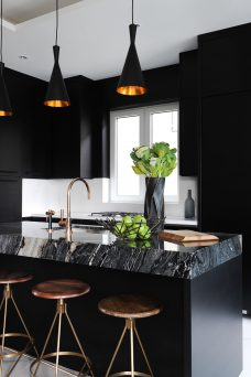 Black marble kitchen top island with black kitchen cabinets