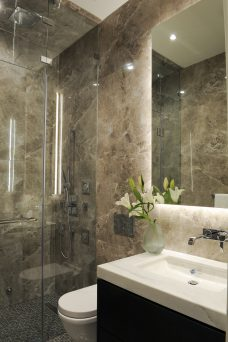 bathroom with marble covered walls