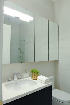bathroom with three cabinet mirrors & single sink