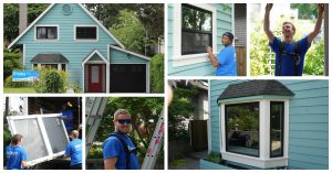 Skilled workers installing new windows on old light blue home