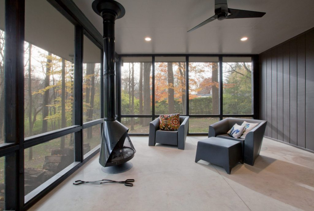 Modern open window style living room with forest view