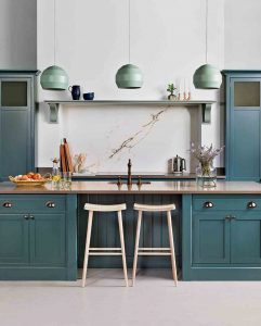 Turquoise kitchen cabinets with creme colour counter tops