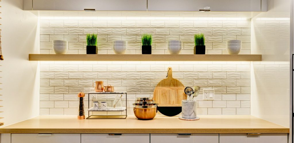 Classy kitchen shelves being lit up by warm side lights